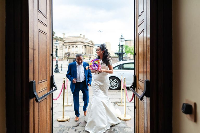 The bride arrives at St Georges Hall with her father