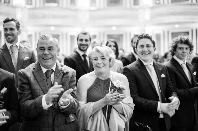 Grooms parents are delighted to see the bride