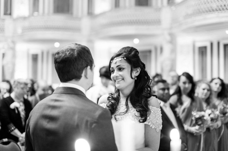 Bride smiles at the groom during speeches