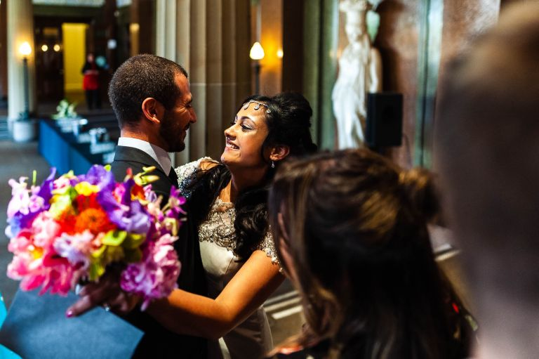 Bride is hugged and congratulated by a guest