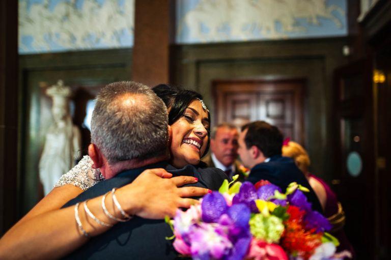 bride hugs a guest