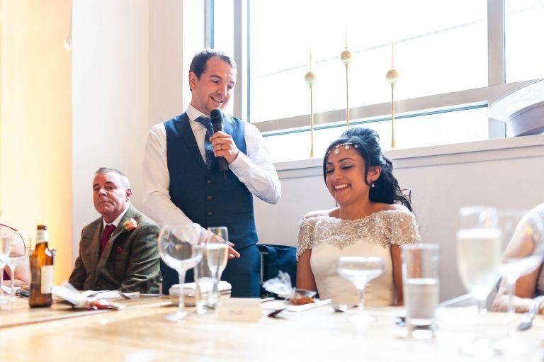bride laughs at Grooms speech