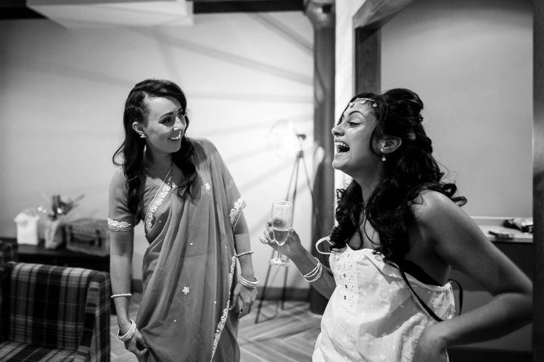 Bride shares a joke with bridesmaids