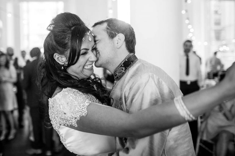 Bride laughing during the first dance