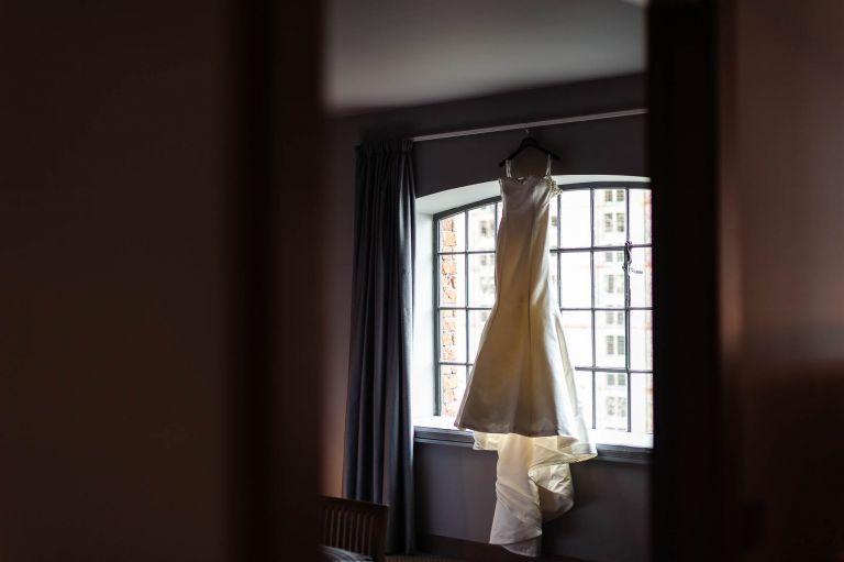 brides wedding dress in window