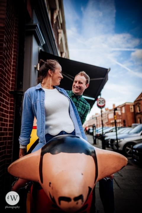 Couple sitting on a Superlambanana