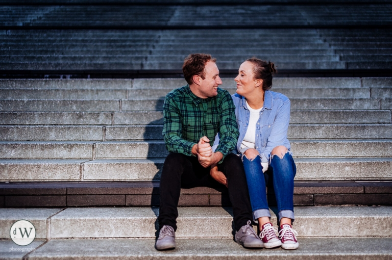 Couple sit on steps
