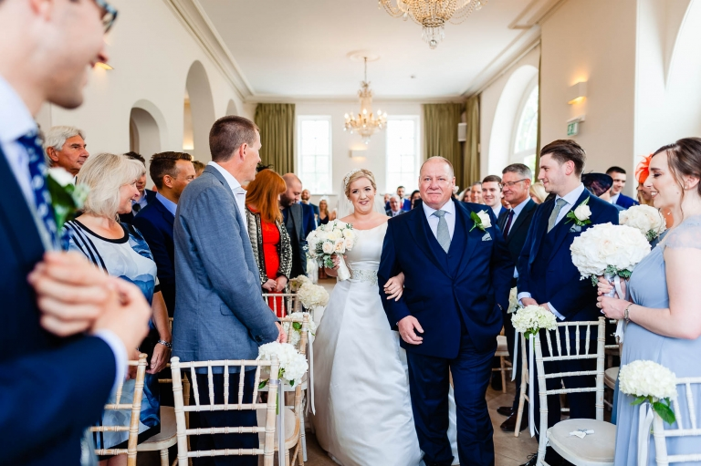 Bride walks up aisle wit her father