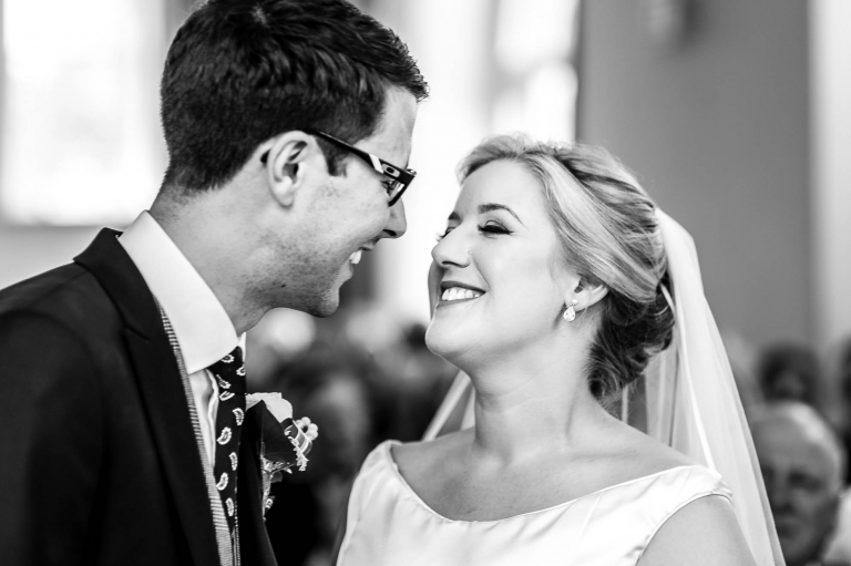 Bride and groom smile after being announced married