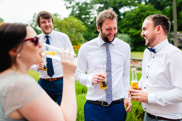 Guests sharing a joke during the drinks receptipon