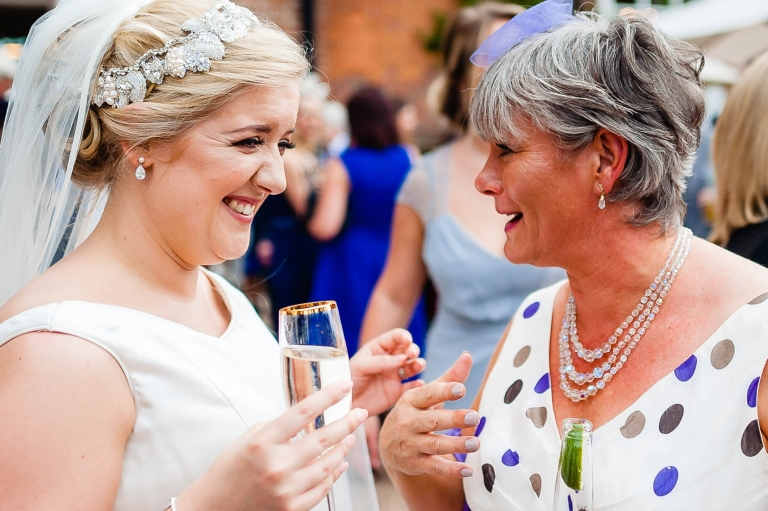 Bride share a joke with guest