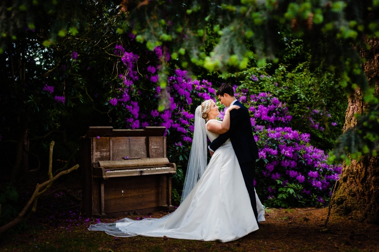 Bride and groom portrait by flowers