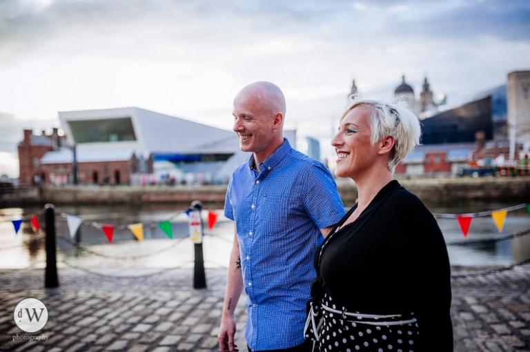 couple walking along Albert dock