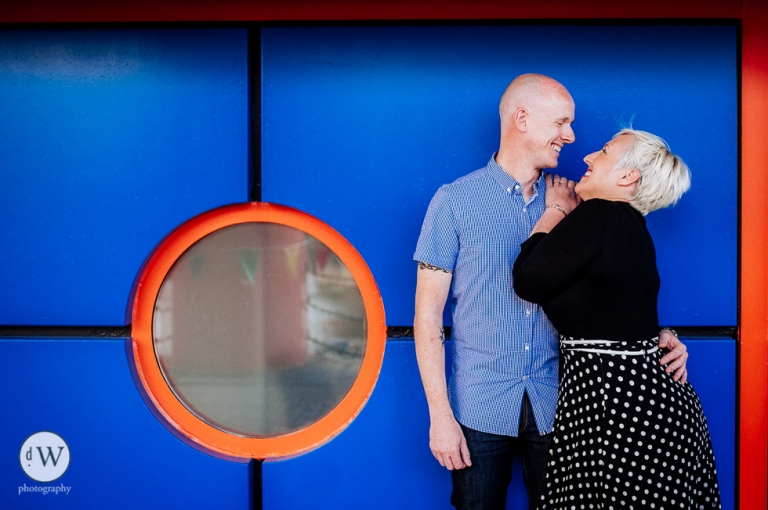 Couple having fun outside Tate Gallery Liverpool