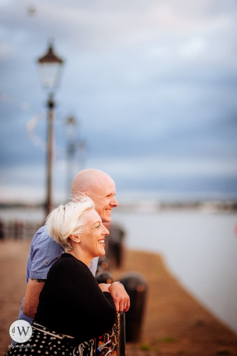 Couple looking out over the river Mersey