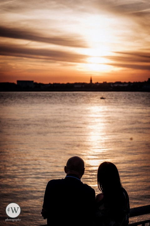 Couple silhouette looking out the Mersey