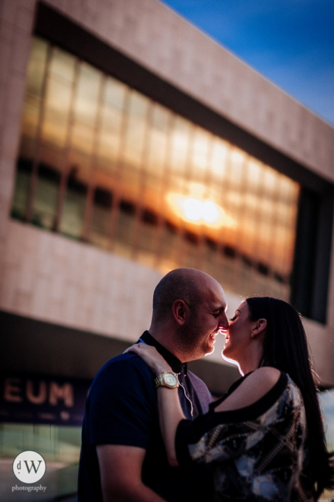 Couple kissing outside Liverpool Museum