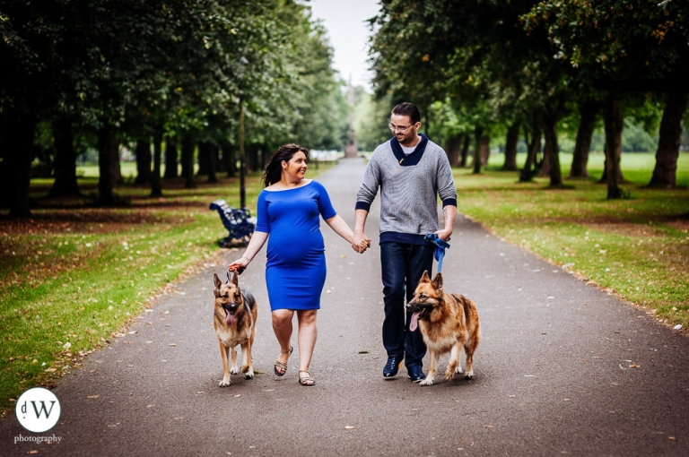 Couple walking with their dogs in Sefton Park
