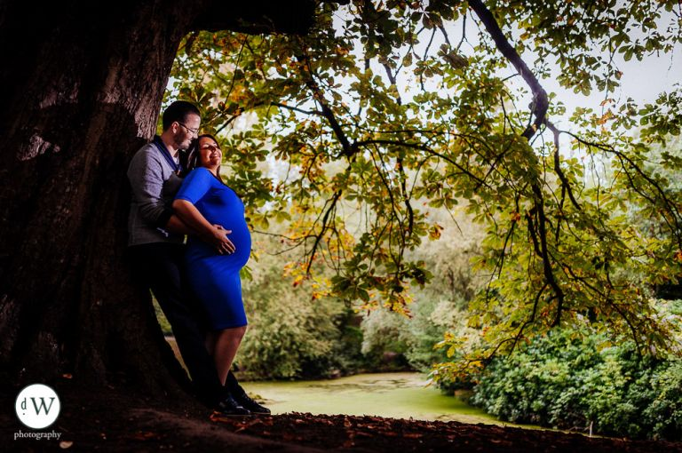 Couple leaning against a tree