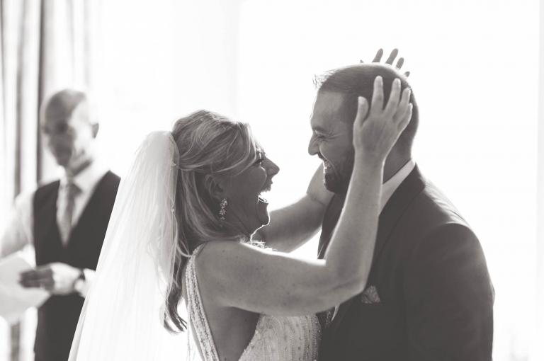 Bride and groom hug each other