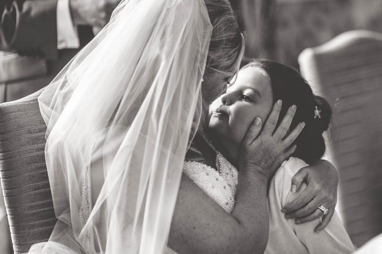 Bride hugs flower girl