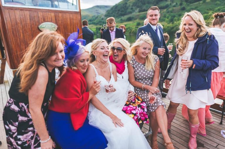 Bride and friends share a joke
