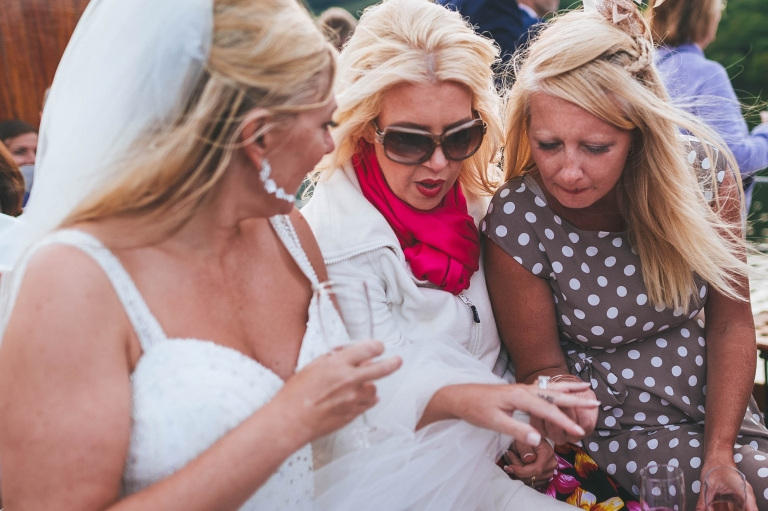 Bride shows her ring to guests