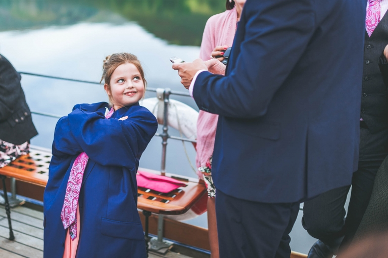 Flower girl wearing mans suit jacket and tie