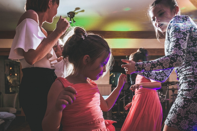 Flower girl dancing with guests