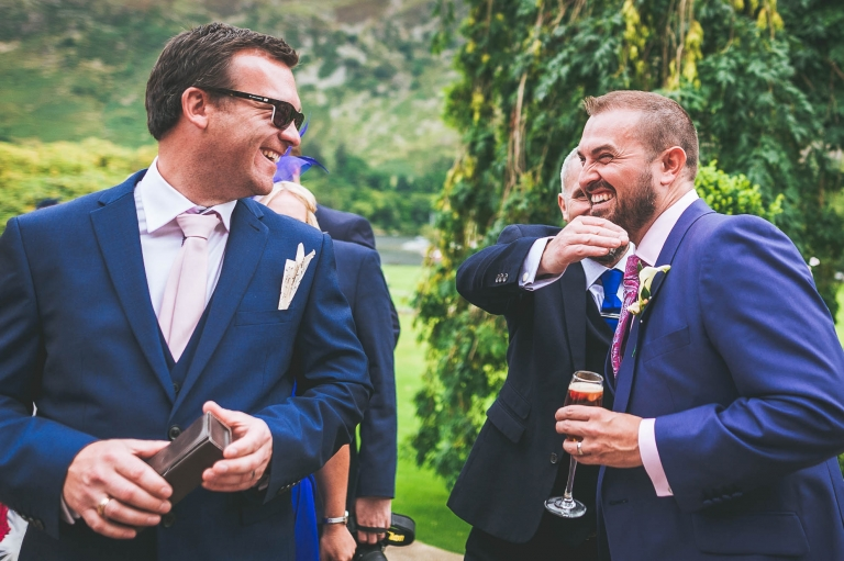 Guest shares a joke with groom