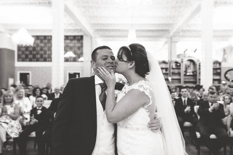 Bride kisses groom after being declared married