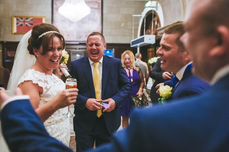 Bride shares a joke with guests