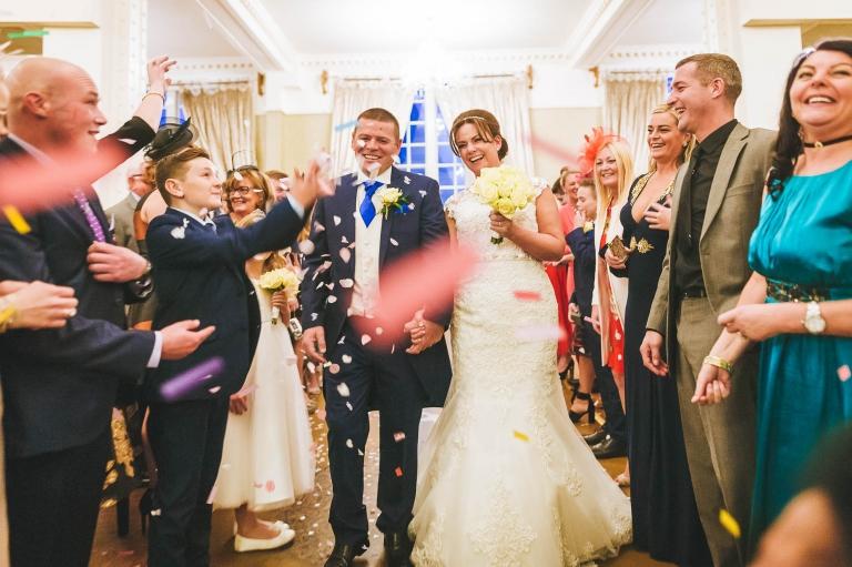 Newlyweds in confetti shower