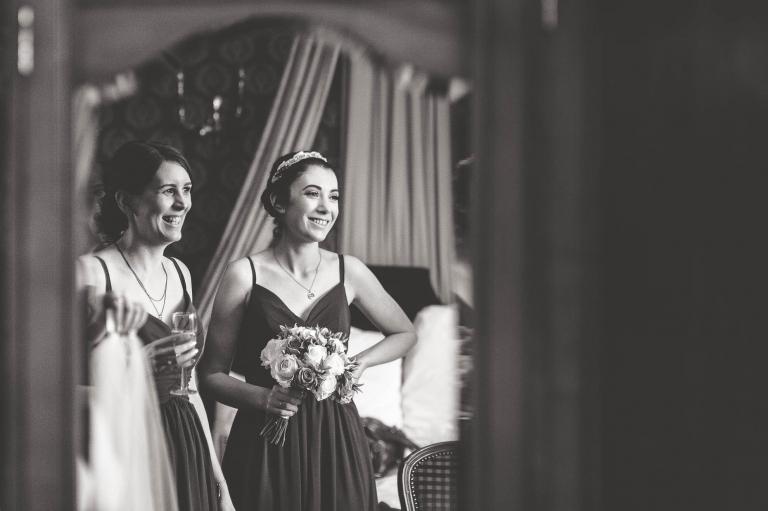 Bridesmaids looking at bride and smiling