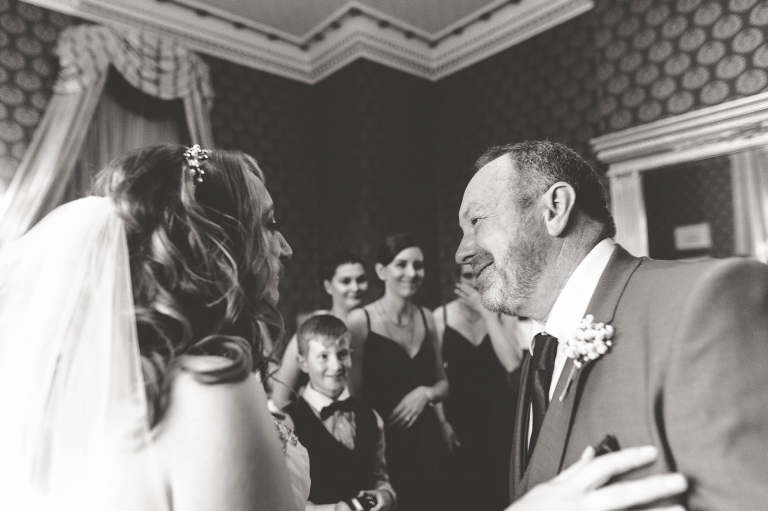 father of the bride hugs the bride
