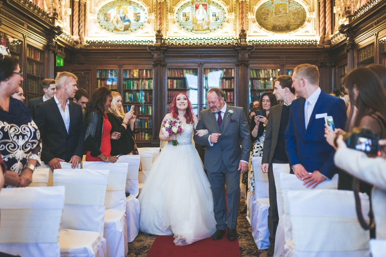 Bride walks up aisle with her father