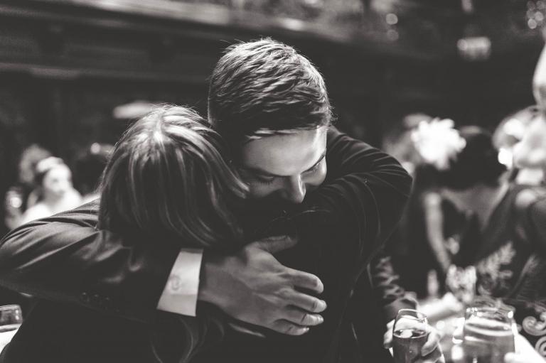 Mum hugs groom