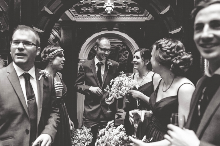 bridesmaids and guest share a joke