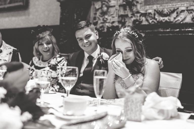 Bride wipes away a tear