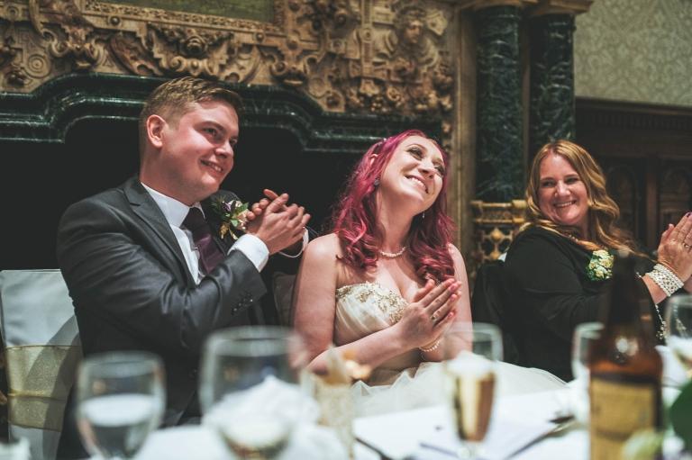 Bride and groom applaud the best man