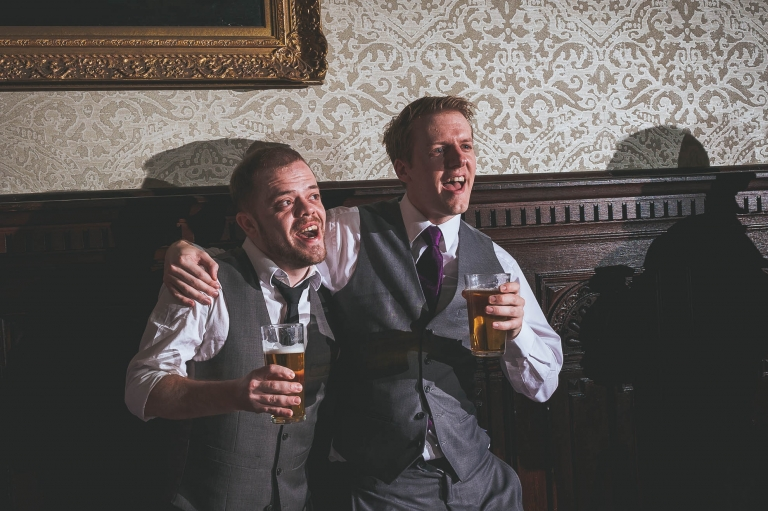 Best man and guest sing