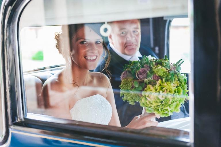 Bride arrives for ceremony in vintage wedding car