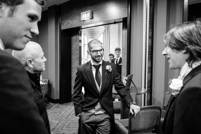 Groom and groomsmen share a joke