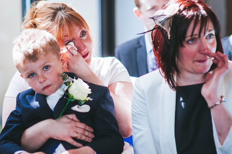 Guests shed tears of joy during wedding ceremony