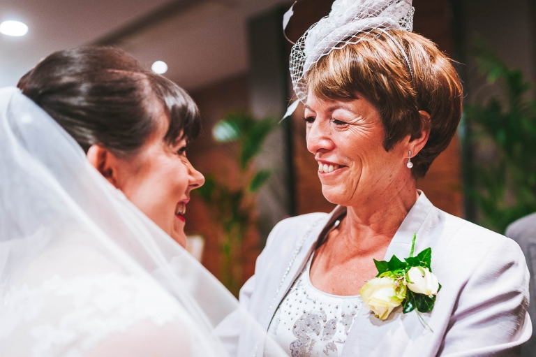 Mother of the groom congratulates the bride