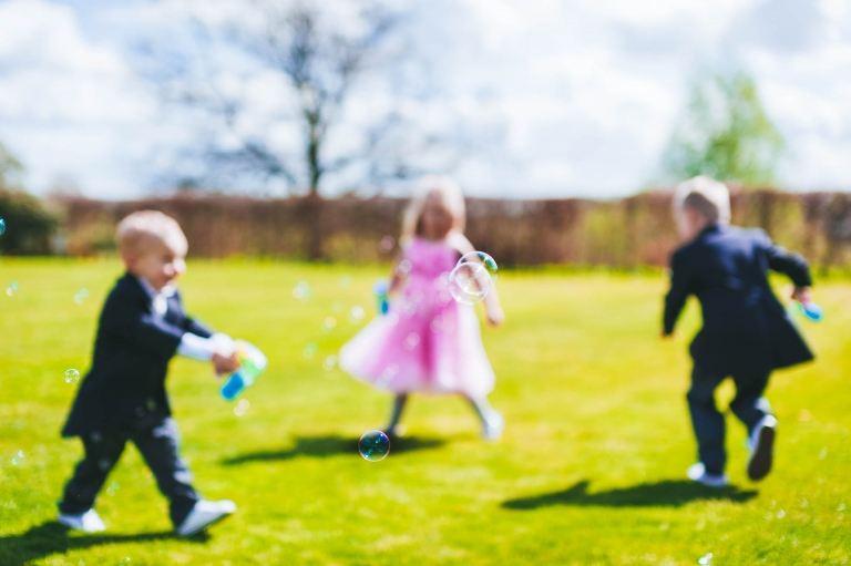 Kids play with bubbles at the wedding