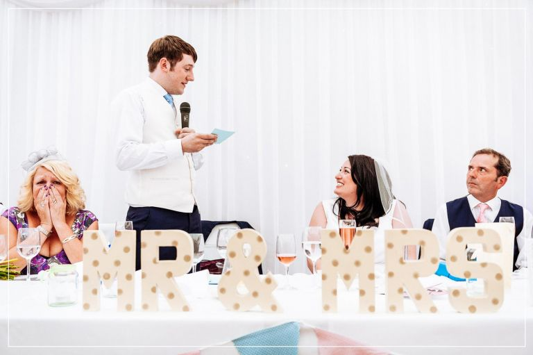 Groom tells his bride how much he loves her during his speech