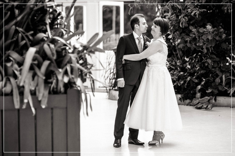 Bride and groom smiling together