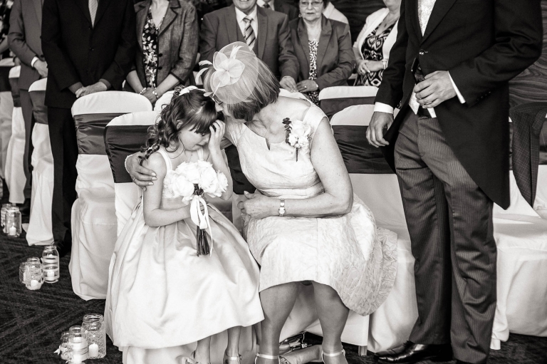 mother of the bride comforts her grandaughter