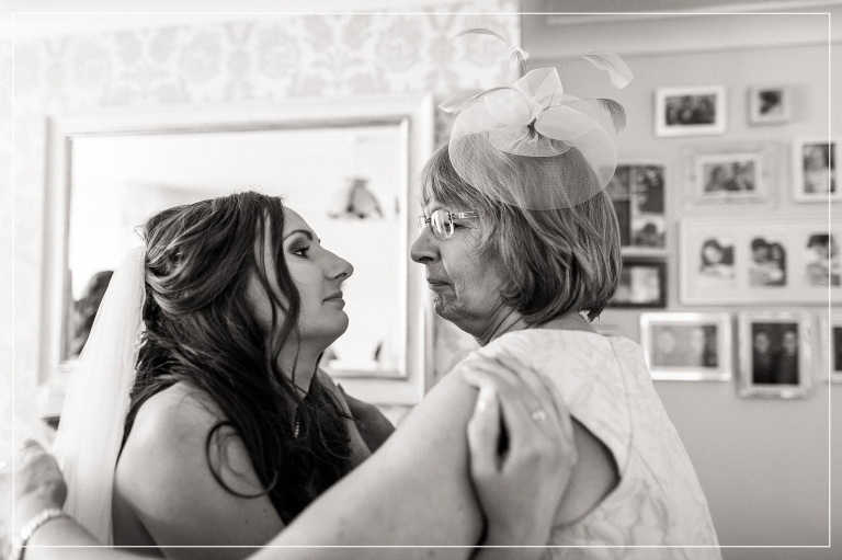 Bride and her mum look into each others eyes